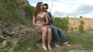 Young lady in brown dress fucked outdoors