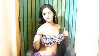 Indian teen brunette Divya touches her alluring pussy with a toy